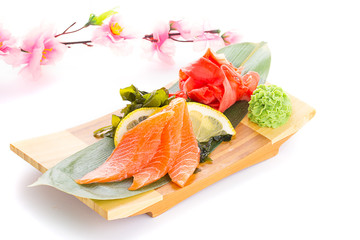 Sashimi on a wooden plate isolated on white background