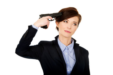 Woman in business suit holding a gun.