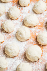 dough balls covered with wheat flour