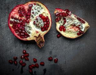 Pomegranate core on black background
