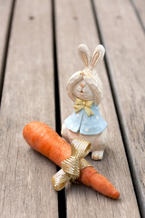 Wood rabbit with fresh carrot present