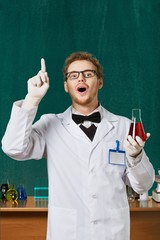 Professor. Mad professor in rubber gloves and spectacles works