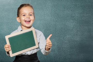 Black. African American school boy holding a blank  black board