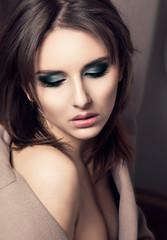 Seductive Young Fashion  Woman Portrait over Dark background.