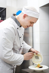chef preparing food in the kitchen at the restaurant