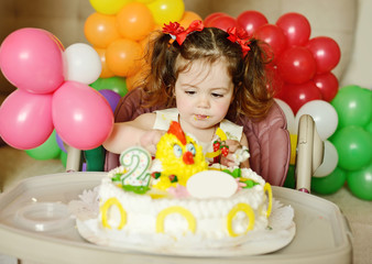 toddler girl with   birthday cake