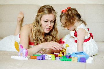 Mother and daughter playing with blocks