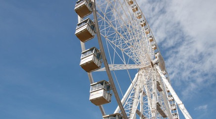 View of Observation Wheel Against the Blue Sky With Clouds