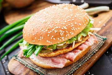 Burger with potato pancake and bacon