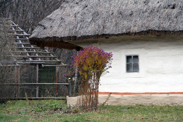 Old traditional Ukrainian clay hut in the village.