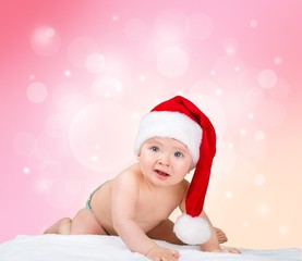 Infant. Little cute girl with santa hat on blue background