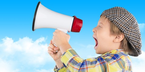 Baby. Kid shouting through vintage megaphone. Communication