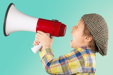 Kid. Kid shouting through vintage megaphone. Communication