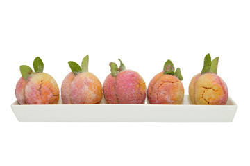 pastries in the shape of a peach isolated on a white background