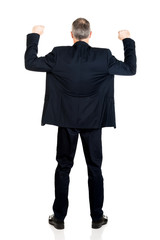 Back view successful businessman with arms up