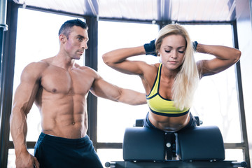 Woman flexing back muscles on bench