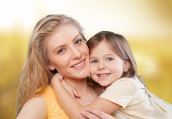 Mom. CLoseup portrait of happy  white mother and young daughter