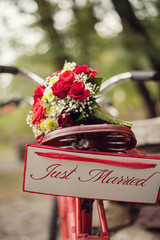 Just married - tandem and flowers