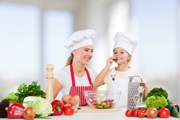 Cooking. Mother and daughter prepare salads