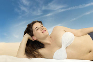 relaxed girl having suntan to the beach