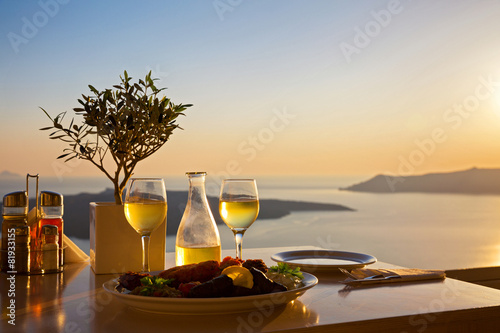 Romantic table for two on the island Santorin - 81933155