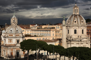 Trajan Column and Baroque churches in Rome, Italy.