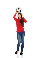 Woman with a soccer ball on head.