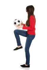 Woman with a soccer ball.