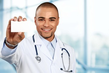 Doctor. Doctor holding blank card