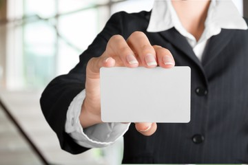 Business. Business card - businesswoman holding blank sign