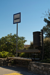 bus stop sign and blue sky