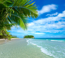 Beautiful tropical beach on the background of island