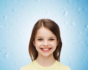 smiling little girl over white background
