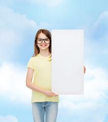 little girl wearing eyeglasses with blank board