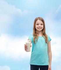 smiling little girl giving glass of milk