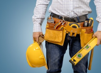 Home Improvement. Man Carpenter Toolbelt Level Hardhat on White