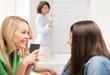 student girls gossiping at school