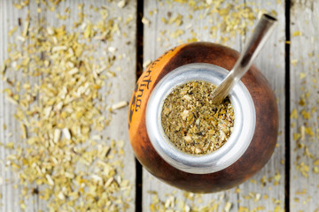 Traditional Argentina yerba mate tea beverage in calabash and