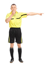 Angry football referee blowing a whistle