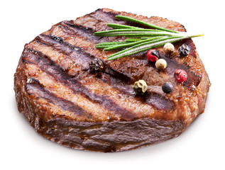 Beef steak with spices on a white background.
