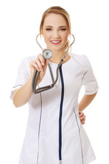 Young female doctor with stethoscope.