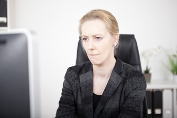Pensive Office Woman Looking at Computer Screen