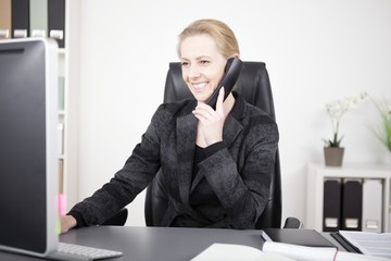 Happy Office Woman Talking to Someone on Phone