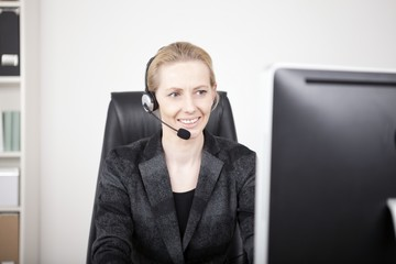 Female Customer Support Sitting at her Office