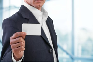 Business Card. Businessman showing his business card