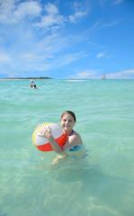 Children enjoying time in beautiful ocean.
