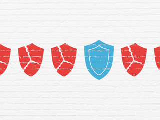 Privacy concept: shield icon on wall background