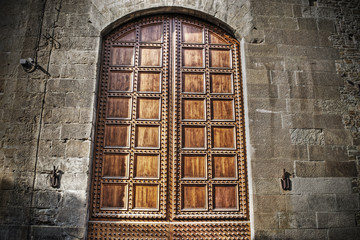 old wooden door in a brick wall in hdr in Florence