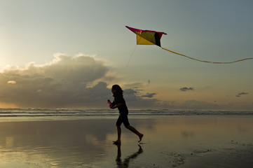 Flying a kite at sunset in Newport, Oregon.