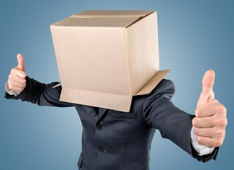 Box. Businessman standing and gesturing with a cardboard box on